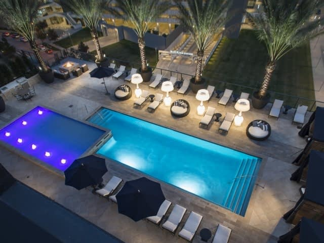 Commercial pool lighting and site furnishing
