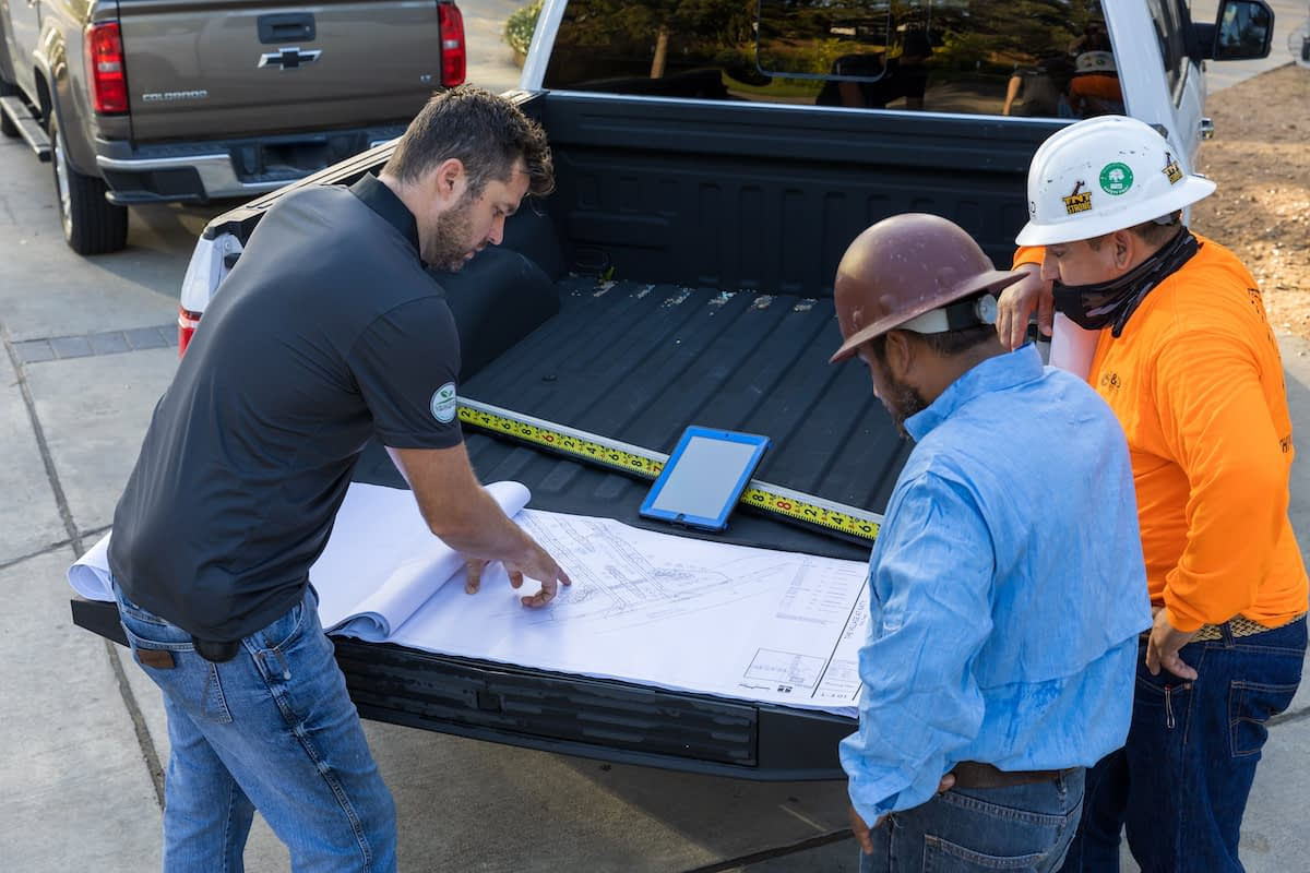 Landscape contractors checking the project blueprint